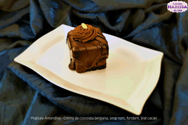 Prajitura Amandina - Blat de cacao, ganache de ciocolata belgiana, sirop rom, fondant.