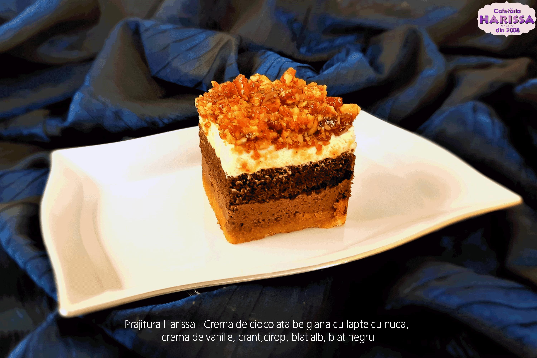 Prajitura Harissa - Crema de ciocolata belgiana cu lapte cu nuca, crema de vanilie, crant,cirop, blat alb, blat negru