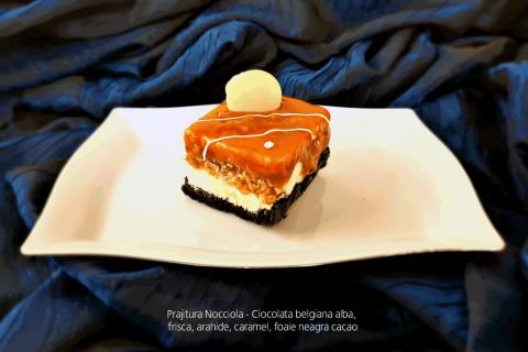 Prajitura Nocciola - Ciocolata belgiana alba, frisca, arahide, caramel.